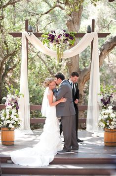 simple ceremony, pops of purple love it ... And this is at the nature center in anaheim