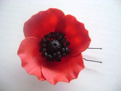 Red Poppy Hair Piece by parsi. $35.00, via Etsy.