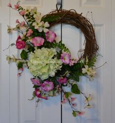 Annabelle Hydrangea Wreath   A sweet accent for your home. The Annabelle wreath is full of warmth and simplicity. A full hydrangea bloom captures your eye and the darling dogwood blossom brings back memories of the renewing hope of Spring. This grapevine wreath with refreshing blooms will brighten your porch. DIMENSIONS 27x20x9.  $66.00
