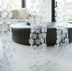 These gorgeous flowers are made from the bottom of plastic bottles!!