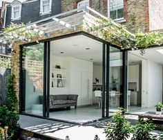 Kitchen extension design with glass sliding doors creates light filled family kitchen glass box. Charles Barclay Architects Kitchen extension design with glass sliding doors creates light filled family kitchen glass box. Extension Designs, Glass Extension, Rear Extension, Extension Ideas, Extension Google, Orangerie Extension, Minimalism Living, House Extensions, Kitchen Extensions