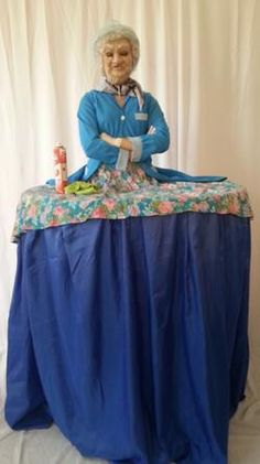 Granny Living Table - This Granny Living Table makes a unique meet and greet centre piece at any corporate or private event. She will tell your guests off for drinking, and then offer help on how to dress and enjoy the night by dancing and kissing all the men!