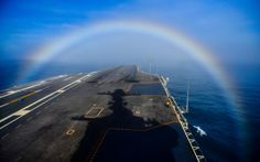 STRANGE MILITARY PICTURES - AMAZING RAINBOW EFFECT OFF BOW OF AIRCRAFT CARRIER!