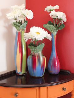 Paint drip vases. You only need 2 supplies. Acrylic paint and and a vase. Cheap and easy and really cool