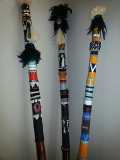 """Spirit Poles"", bamboo with paint,  beads and feathers."
