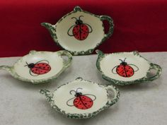 This is a set of 4 tea bag holders.They are approximately 3 1/4 X 4 1/4 hand painted in our Lady bug design and sponged green on the outer edge in our own under glaze. This makes a great gift. They can be used as a tea bag holder, a place to put your ring, spoon, brillo pad or can be used as a lollipop or gum catcher. We cast them in stoneware slip, hand painted in our own food safe under glaze no two are exactly alike since they are hand painted, then they are fired and glazed in o...