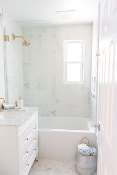 Before and After: See a Dark, Damp Bathroom's Carrara Marble-Filled Transformation & Apartment Therapy Source by emegswope The post Before and After: See a Dark, Damp Bathroom's Carrara Marble-Filled Transformation appeared first on Bethany DIY. Diy Bathroom Decor, Bathroom Renos, Bathroom Interior, Master Bathroom, Bathroom Ideas, Lowes Bathroom, Bathroom Remodeling, Bathroom Showers, Gold Bathroom