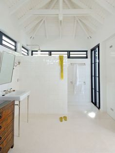 open, clean bath.  crisp white + black windows