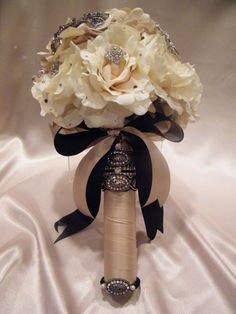 Do you think I could get away with this bouquet, but replace black with grey?!?! It's definitely a spin on a traditional bridal bouquet and I love it!