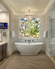 cool tub and faucet.  TV in the bath?  I wonder if it reaches around the corner so you can watch while in the tub.  Also will need the mirror on the wall.  cool