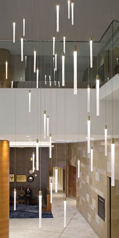The Multispot Tooby hanging light is made of glass with grey metal or copper details and LEDs. Great impact lamp, ideal for hotel lobbies and large spaces. Office Lighting, Modern Lighting, Lighting Design, Modern Interior Design, Interior Design Living Room, Interior Architecture, Light Fittings, Light Fixtures, Atrium Design