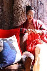 Waejong (co-owner of Loopy Mango) knitting.  Design Legacy blue bird pillow.