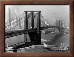 View of the Brooklyn Bridge and the Skyscrapers of Manhattan's Financial District Photographic Print by Andreas Feininger at Art.com