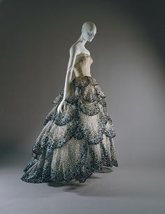 """Junon"" dress, fall/winter 1949–50  Christian Dior (French, 1905–1957); Christian Dior Haute Couture (French, founded 1947)  Pale-blue silk net embroidered with iridescent blue, green, and rust sequins"
