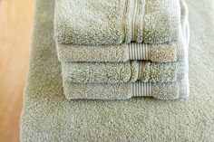 Recharge Your Towels | Run through the wash once with vinegar (no detergent), and then again with baking soda (again, no detergent).