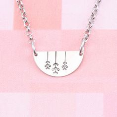 Simple yet pretty with flowers metal stamping on this half circle metal stamping blank necklace.