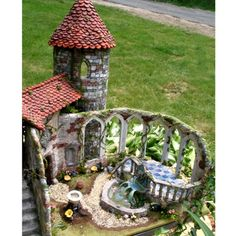 This the coolest miniature castle! The details are lovely.  http://www.etsy.com/listing/14279403/custom-dollhouses-and-roomboxes-large?ref=af_circ_circle