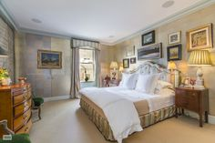 Master bedroom decorated by Miles Redd design in a prewar cooperative apartment on the upper east side.  Why would someone hang a framed painting over a closet door?