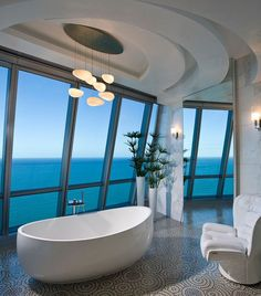 Fabulous Bedroom Design with Hotel Ambience : Stunning Penthouse Bathroom With Stylish White Oval Bathtub And Wide Glass Wall