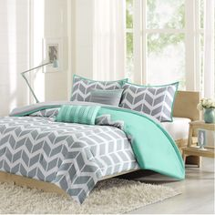 Laila makes any bedroom fun and inviting. The comforter features a fresh solid teal color with a gray and white chevron print that runs along the bottom broken up by white vertical stripes.