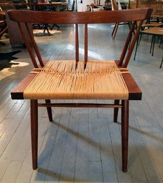 George Nakashima - Set of Four Walnut and Woven Seat Chairs | InCollect