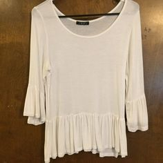 White Ruffled Top Only worn a couple times. Perfect white color! Deb Tops Blouses