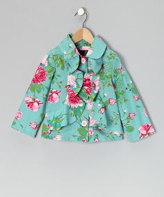 Vibrant colors and a floral print put a stylish spring in this jacket's step. Crafted out of canvas, it's got two rows of ruffles cascading down both sides of the bright button closures.100% cottonMachine wash; tumble dryMade in the USA