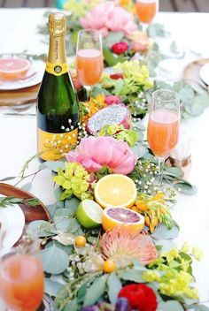 Love the fruit and floral design for a vibrant, fresh party table!
