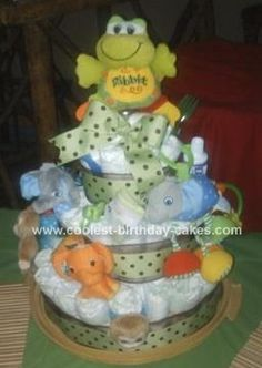 Homemade Jungle Toy Diaper Cake Idea... This website is the Pinterest of diaper cake ideas