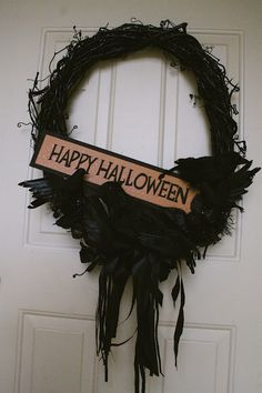 I'm thinking - wreath from Michaels (spray paint black) + ravens & garlands + cute sign = super cute wreath! Supes easy and affordable!