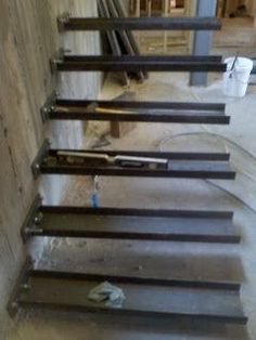 The initial balance test      C-Channels cantilevered from concrete wall with epoxy anchors     4x12 Cedar treads routed to accept C-Chann...