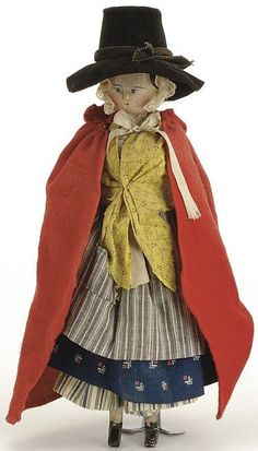 England, late 19th century, young lady peg wooden doll with carved and painted features, all original Peddler Doll / Welsh clothing with red wool cape and black velvet hat, 14 Inches.jpg