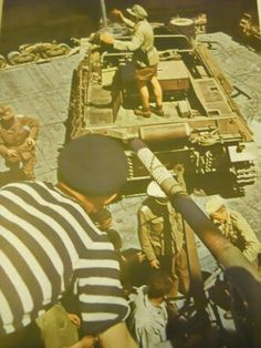 Rare color photo of a 15cm sIG33 (Sf) II being unloaded in North Africa