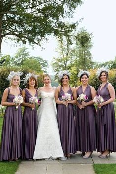 love how the tops of all the bridesmaids dresses are different, but they're all the same color, and all the bottoms are different. great idea!!