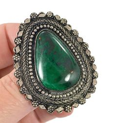 I love chrysocolla as the colors are always so stunning! This is a large piece of veined chrysocolla that is also known as the Eilat Stone or Solomon Stone. This is a vintage sterling silver pendant / pin / brooch. The color in this piece is just amazing. It is surrounded by layers of