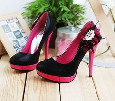 Black with hot pink heels and platforms, also black and pink feathers