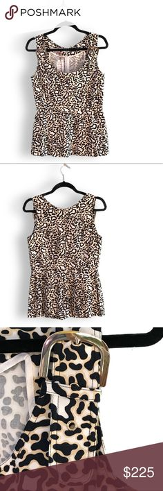 "Stella McCartney Animal Print Sleeveless Top NWT White and multicolor Stella McCartney sleeveless top with scoop neck, gold-tone buckle closures at straps, animal print throughout, peplum feature at waist, hook-and-eye closure and invisible zip closure at center back.   Bust: 35"" Waist: 28"" Length: 25.5"" Stella McCartney Tops"