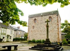 Dalton Castle is a peel tower, standing in the market place of Dalton-in-Furness, Cumbria. It was erected by the abbot of nearby Furness Abbey in the 14th century in an attempt to defend abbey property from Scottish raids.