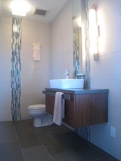 "practical. 12""x24"" Dal tile floor and wall tile. Porcelanosa vanity ..."