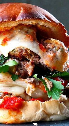 Mega Meatball Sandwich ~ Simple yet flavorful tomato sauce atop toasty fresh buns, smashed herbed meatballs, and melty mild Provolone cheese... Holy meatball madness