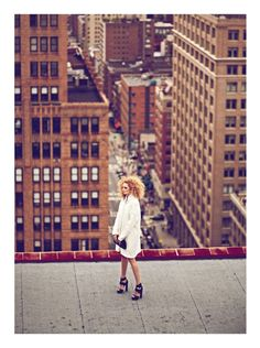 I'd love to do family photos on top of a building like this with the city in the background. With nice clean lines.