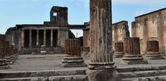REPUBLIC ERA - ROMAN TOWN PLANNING, Pompeii: Remains of Basilica at The forum, 120 BC. There is a tribunal (on which the judge would sit) at the end of the basilica.