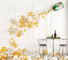This champagne bottle balloon makes a perfect New Year's Eve party decoration! Pick it up at partydelights.co.uk or browse more New Year's Eve party ideas on our blog.