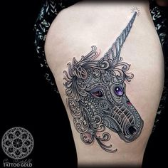 Love the design and detail in this unicorn head tattoo.