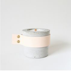 Candle with leather strap.