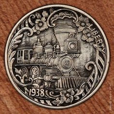 """""""Train #99"""" - Hobo Nickel hand-carved by Aleksey Saburov (2014);  Saburov states that each coin """"is unique, crafted in bas-relief under 10X magnification. ... Each individual coin has its own number to ensure its authenticity and is signed by me as the master engraver."""""""
