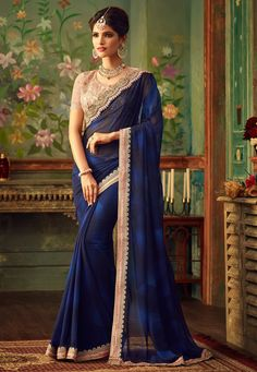 Blue net half and half sari. This sari is beautified with heavy floral embroidery and embroidered lace border work. It comes with a matching embroidered unstitched blouse. Designer Sarees Wedding, Latest Designer Sarees, Saree Wedding, Wedding Wear, Wedding Gowns, Latest Indian Saree, Indian Sarees Online, Indian Saris, Indian Ethnic