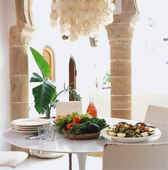 Dar Beida is in Morocco, in the back of the Medina of Essaouira. (Love the Capiz shell Chandelier ... I'm on my way ツ)