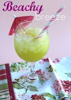 Beachy breeze - Midori (melon liqueur) + Malibu (coconut rum) + Pineapple juice. {lots more yummy drink ideas at the site}