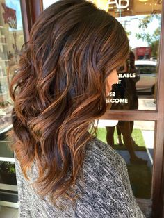 Rose gold and caramel balayage and waves on brunette hair